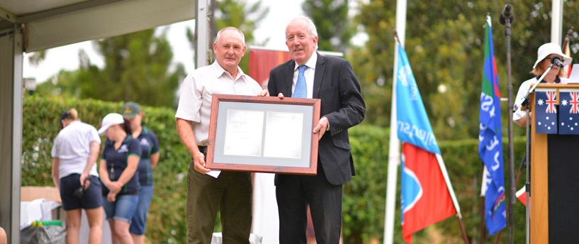 Australia Day 2017 Dubbo Citizen of the Year Mick O'Neill accepting his award from Dubbo Regional Council Administrator Michale Kneipp.