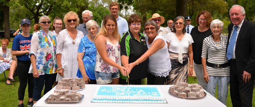 Australia Day 2017 Wellington Award Winners, Australia Day Ambassador Amanda Reid, and Dubbo Regional Council Administrator Micahel Kneipp cutting the cake at official celebrations in Cameron Park