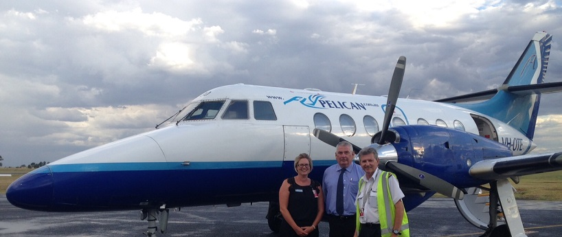 Acting Manager Dubbo City Regional Airport Natalie Nissen, Council's Director of Corporate Services Ken Rogers and a FlyPelican Pilot stand in front of a FlyPelican aircraft at the Dubbo Regional City Airport on 1 February 2017, the day that flights between Dubbo and Canberra were introduced.