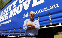 Transforce Managing Director Steve Fieldus standing in front of one of the company's fleet vehicles that promotes Dubbo as