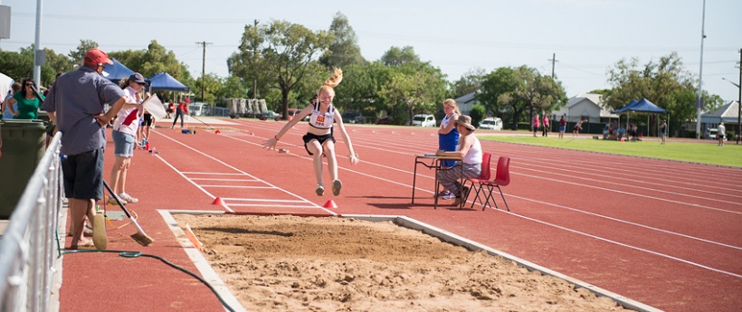 Girl performs long jump at Barden Park Centre of Excellence for Athletics at Dubbo
